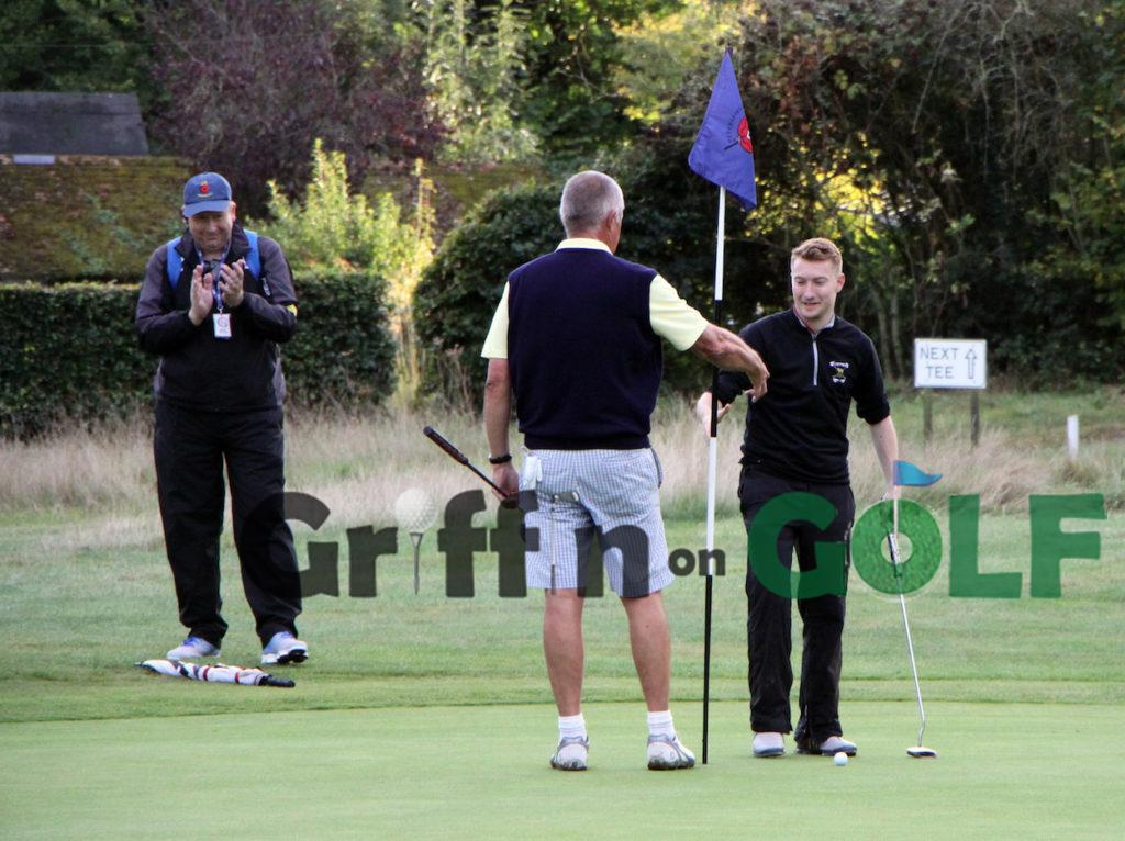 Henry Lloyd shakes Dave Edmunds hand after winning their County Sevens match at the 20th at Petersfield Golf Club